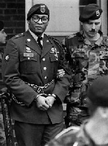 Prvt. Ronald A. Gray being led away in 1988.