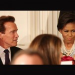 First Lady Michelle Obama and Arnold Schwarzenegger.  Is she even talking to him?