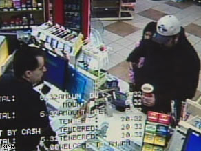 Surveillance video of man robbing mini-mart with daughter next to him.