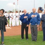 Patti Labelle sings national anthem while Colin Powell and others stand in salute