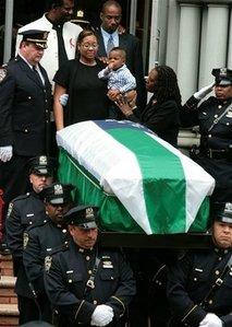 Omar Edwards widow Danielle and their son Xavier.