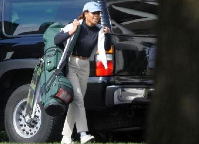 Domestic Policy Advisor Melody Barnes prepares for golf outting with the President October 25, 2009.