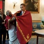 obama putting on garb