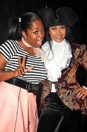 Lisa Wu-Hartwell and a fan...(what is Lisa wearing and why do her eyes look like that)??