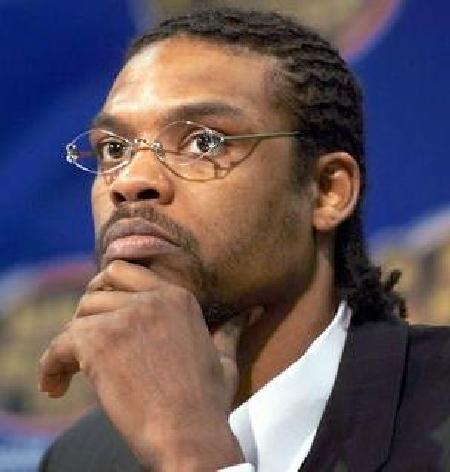 latrell_sprewell(00-in-suit-hand-to-chin-med-large)