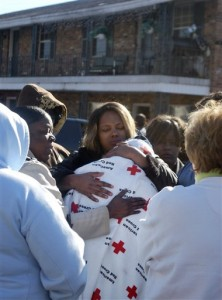 Chassel Jenkins, in blanket, is comforted by friends after a fire moved through an apartment complex where Chase lived, Monday, Dec. 28, 2009, in Starkville, Miss. Nine people, including at least six children, died early Monday in an apartment fire, officials said. The blaze was reported around 4 a.m., according to Oktibbeha County Coroner Michael Hunt. He and state Fire Marshal Mike Chaney confirmed the deaths. Hunt said the children ranged in age from 4 months to 6 years. (AP Photo/The Starkville Daily News, Shea Staskowski)