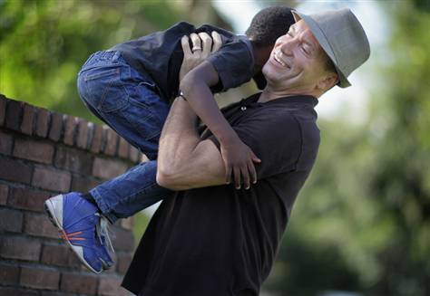 Martin Gill with adopted son. The gay community of Florida is assuredly ...