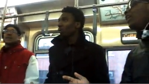 Unidentified singing talents on Chicago's L Train.