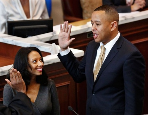 T.J. Shannon, 34, is sworn in as first African American Speaker of the House for Oklahoma as his wife Devon looks on.