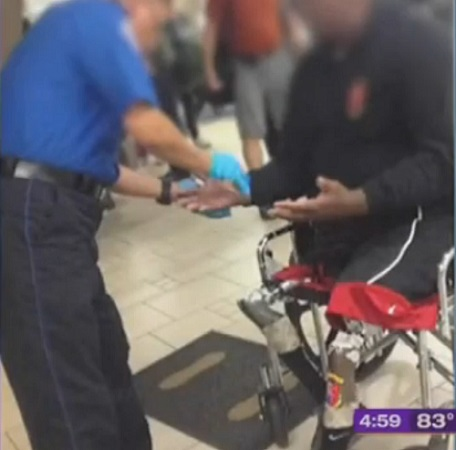 Unidentified active duty Marine was allegedly made to remove prosthetic legs and checked for explosives at Phoenix Sky Harbor Airport, March 13, 2013.