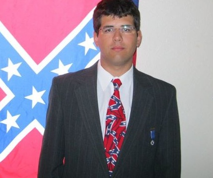Matthew Heimbach standing in front of a confederate flag is the founder of the White Student Union at Towson University in Towson, Maryland.