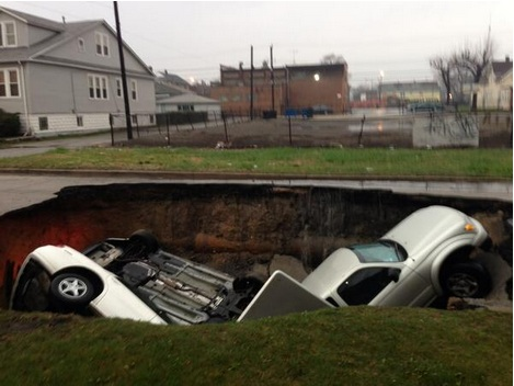 Chicago sinkhole on the Southeast side swallowed three cars before residents' eyes Thursday morning, April 18, 2013.
