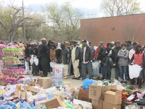 Residents near Lanway Grocery Store in Augusta, Georgia, patiently await food distribution when the store's owner was evicted.