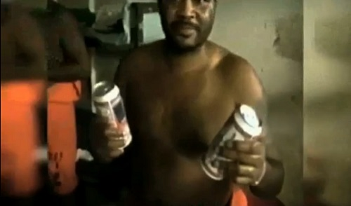 Unidentified inmate reaches in a cooler and retrieves a couple cans of Budweiser.