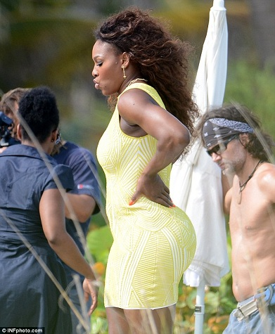 Serena sporting a sunshine dress that captures all of her curves.