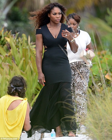 Serena in a black multi-strapped hip hugging gown.