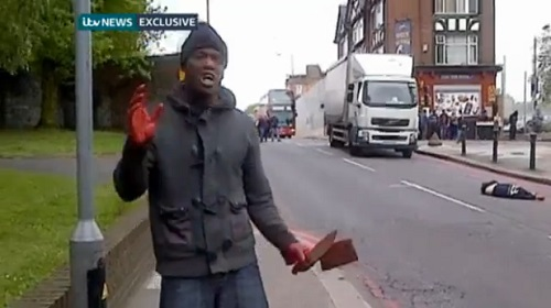 The religious fanatic that decapitated a british soldier in the streets and stands with the man's blood on his hands wielding a butcher knife and meat cleaver of London's Woolwich area tries to tell a cameraman why he has committed such a heinous act against a innocent man.