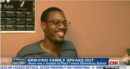 Joshua Hardy gleams with happiness as he remembers his 9-year-old daughter Jenae Hornsby, who was killed in the tornadoes in Moore, Oklahoma, Monday, May 21, 2013.