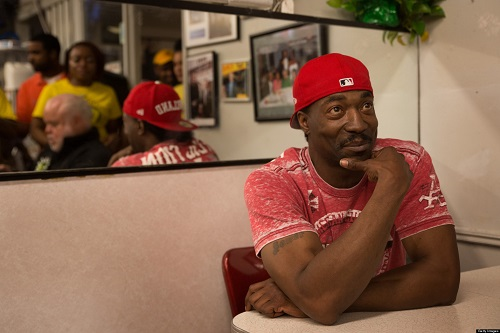 Washington,DC- MAY 11   Charles Ramsey poses for customers at Ben's Chili Bowl in downtown DC. Talk Show Host Rock Newman who brought Ramsey to town. Ramsey has been hailed a hero for his efforts to free the three women held against their will by Ariel Castro. (Photo by Lucian Perkins/For The Washington Post via Getty Images)