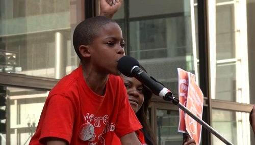 Asean Johnson is a third grader at Marcus Garvey Elementary in Chicago and he is fighting to keep his school open during protests Monday, May 20, 2013.