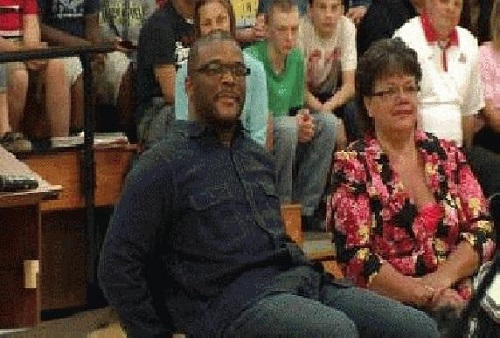 Tyler Perry surprises middle school students in Columbus, Ohio, with $100,000 donation at musical concert.