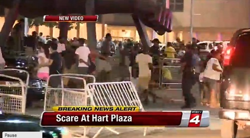 Chaos erupts when residents think they hear gunfire during Detroit Fireworks show Monday night, June 24, 2013.