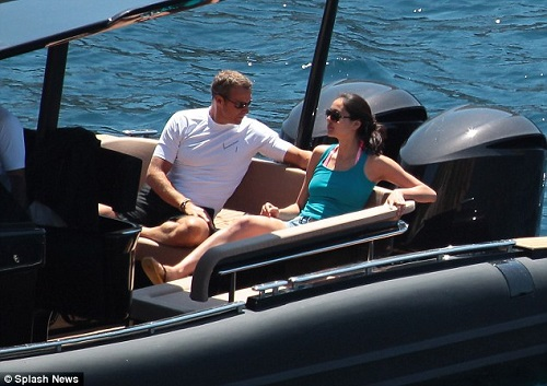 Vladimir Doronin soaking up the sun on a boat with Luo Zillin.
