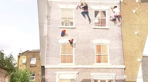 Well known optical illusion artist Leandro Erlich's new piece Dalton House immediately incited family participation in the East London neighborhood of Brickney  on its opening day Wednesday, June 26, 2013.