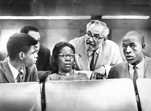 Rena Price flanked by her sons Marquette Frye (right) and Wendell Pierce (left) during a Senate Hearing in August  1965.