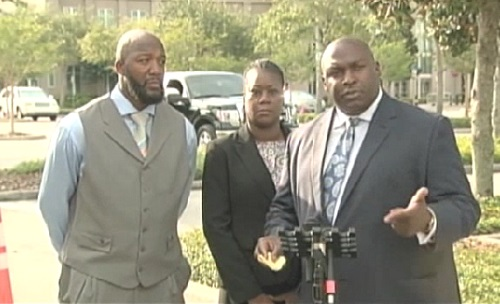 "Trayvon Martin's parents stand with their attorney Daryl Parks as he tells the press outside the Seminole Court how ""proud"" the family is of Rachel Jenteal."