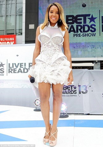 Angela Simmons in a futuristic icy, breast plated, short dress with stilettos.