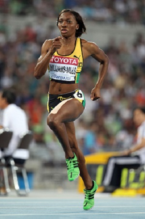 Novlene Williams-Mills, 31, wins bronze in London, June 25, 2012, after being diagnosed with breast cancer days before win.