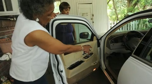 Ceola Walker, 77, shows the many bullet holes in her car and home after police fired at her son, Roy Middleton, 60, as he searched for a cigarette in her car, Saturday, July 27, 2013.