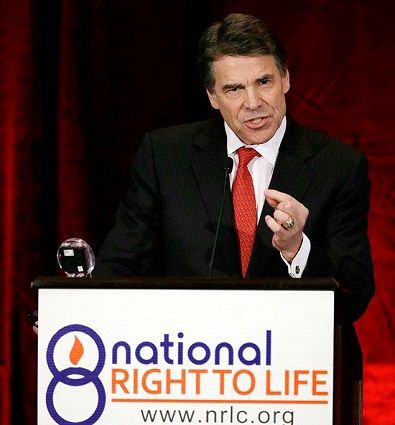Texas Gov. Rick Perry signs abortion law that will likely close most of the abortion clinics in Texas, Thursday, July 18, 2013.