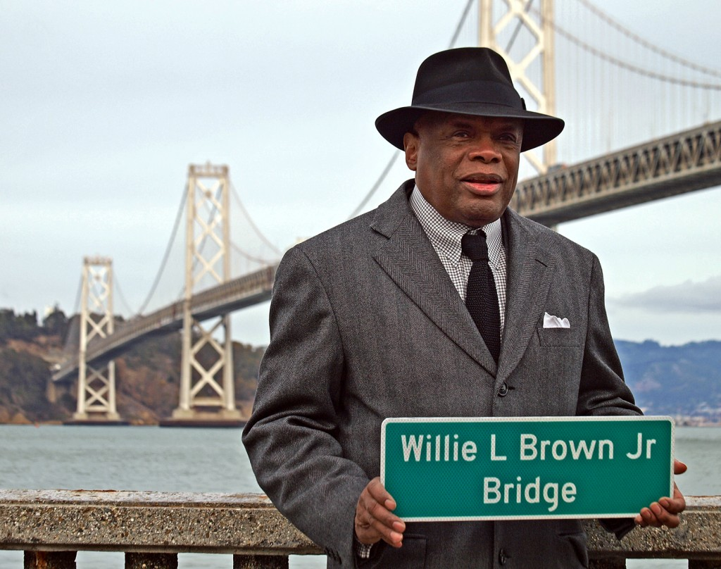 Former San Francisco Mayor Willie L. Brown holds a sign that now officially hangs on the Bay Bridge. Any questions?