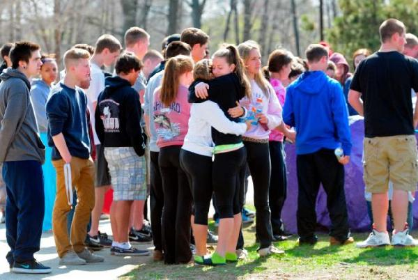 Students gather to mourn their friend, Maren Sanchez, together. Purple was her favorite color, so they spray painted a rock purple and put her name and birth date on it