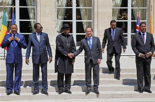 French President Francois Hollande, third right, shakes hands with Nigeria President Goodluck Jonathan as others, from left, Niger's President Mahamadou Issoufou, Chad's President Idriss Debi, Cameroon President Paul Biya, Benin president Thomas Boni Yayi, look on at the Elysee Palace in Paris on Saturday.