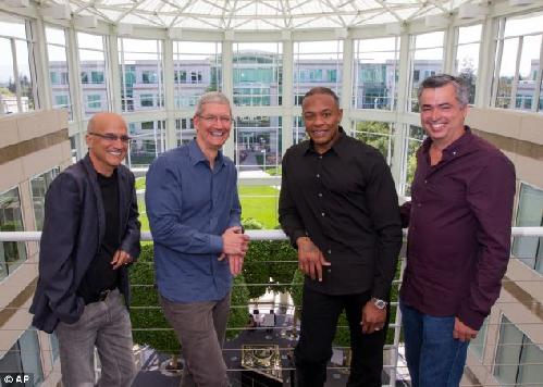 Beats by Apple, from left to right, music entrepreneur and Beats co-founder Jimmy Iovine, Apple CEO Tim Cook, Beats co-founder Dr. Dre, and Apple senior vice president Eddy Cue pose together at Apple headquarters in Cupertino as Cook revealed Apple's $3 billion acquisition of Beats Electronics