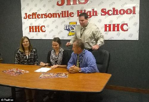 Female signs on to play university football
