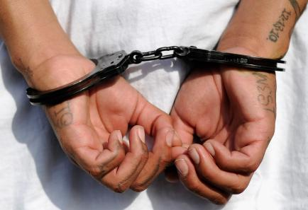 Handcuffs on the hands of a youth arrested by Los Angeles police on April 29, 2012