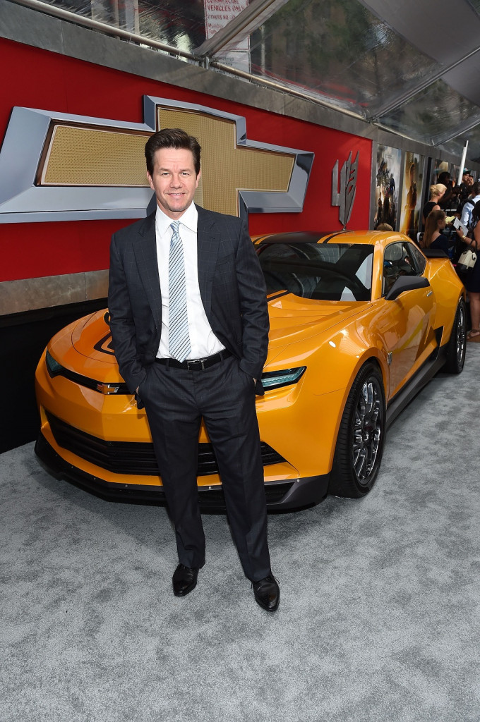 "Transformers star, Mark Wahlberg, stands in front of a ""very special"" car at the Ziegfeld Theatre in NYC (June 25, 2014)"