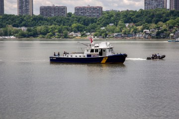 The NYPD searches for Adeoye's body in the Hudson River Friday. Photo: Warzer Jaff