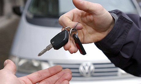 car and keys being handed over