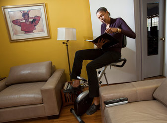 Dr. Toni Yancey, professor of health services at U.C.L.A., gets work done while riding a recumbent bicycle at home. She also uses a treadmill desk at the office.Credit Stephanie Diani for The New York Times