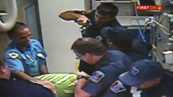 Police hold Earl Baldwin, Jr. down and tase him