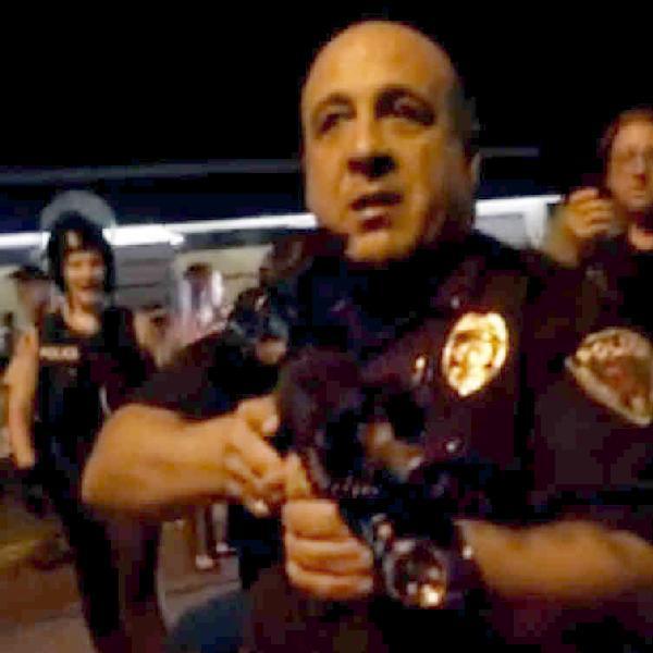 Ferguson cop waves gun, curses