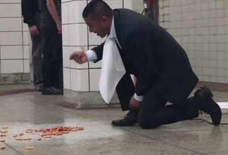 Vacuum salesman eating off subway floor