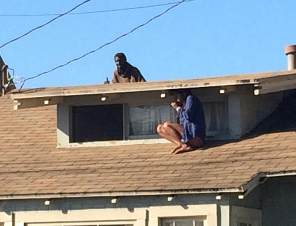 Woman hides on roof