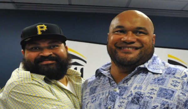 Chris Kemoeatu (left) hugs his brother, Ma'ake Kemoeatu, who gave him a kidney
