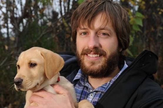 Justin Priest holds his 9-week-old yellow lab Lily in Anchorage on Thursday, Oct. 9, 2014.
